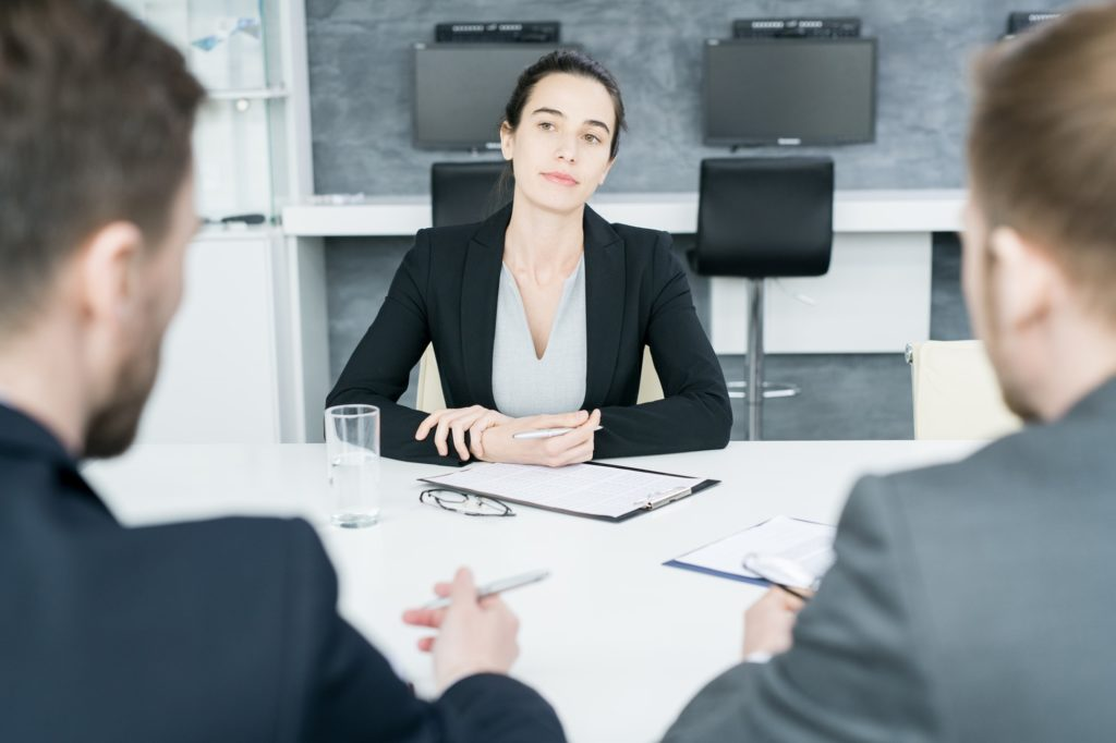 Female Boss Listening to Partners at Negotiations